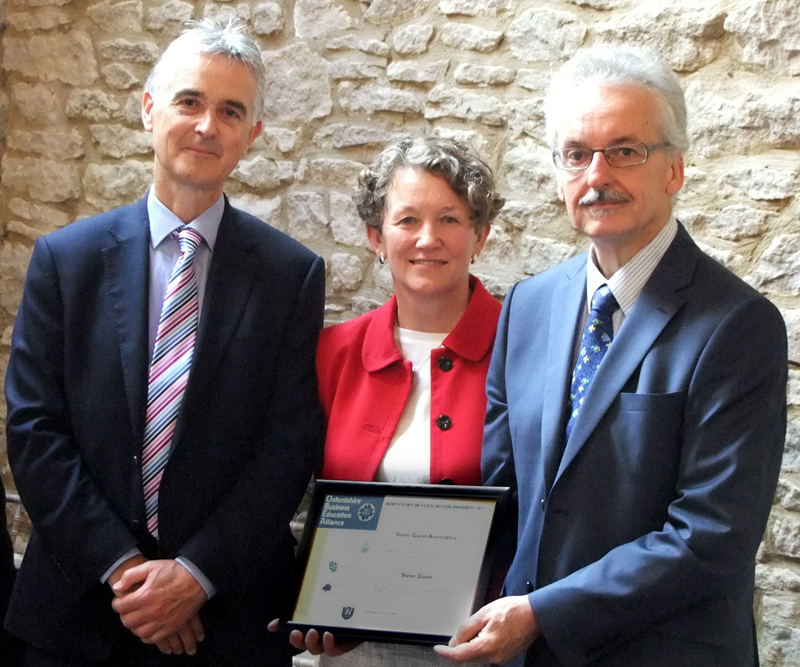Steve Gunn (right) receives his award from David Wybron, Head of Lord Williams's School and Kate Curtis, former Head of Wheatley Park School and now Education Quality Associate for the River Learning Trust.